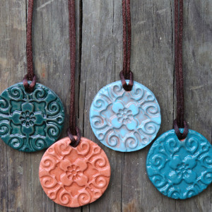 Diffuser Necklace Color Options: From let to right: Jade, natural, earth blue, turquoise